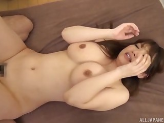 Busty Japanese MILF squeezes her tits as she gets her pussy creamed