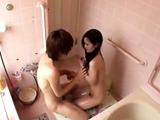 Bodacious Asian teen feeds will not hear of hunger for cock in be passed on shower