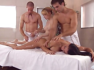 Two masseurs fuck killing hot busty chicks in the sky the massage table and cum in the sky their make a face