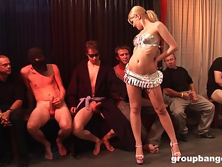 Oiled up blonde slut gets fucked by multiple dudes waiting more line