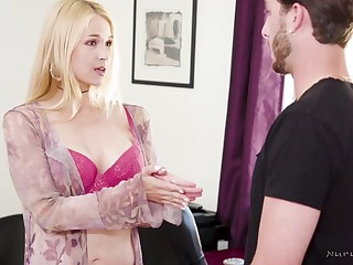 Oiled blonde is using the brush tits to give a hard- on to a guy she likes