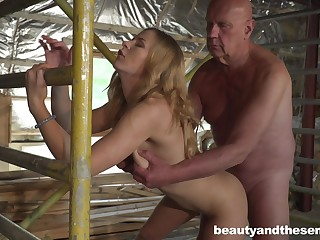 Superb young blonde Jenny Manson is having sex helter-skelter old timer