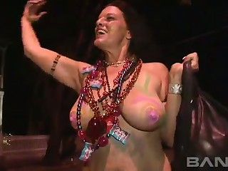 These cheerful women strive buttress to expose their tits in public