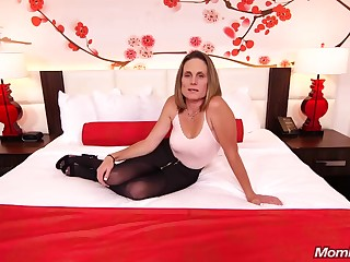 Phthisic brunette milf with saggy tits, Judith, is riding a hard white cock for a camera