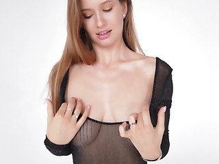 Charming beauty Stella exposes and plays with her juicy boobies